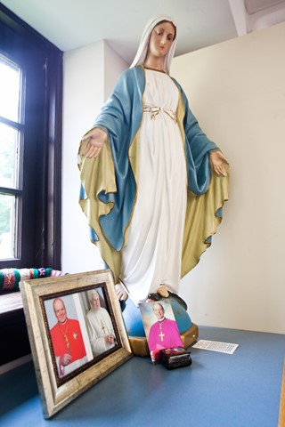 Our Lady of GraceOur Lady stands watch over the work area in the shipping department.